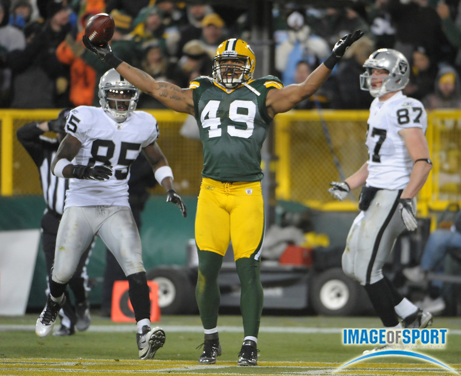 Dec 11, 2011; Green Bay, WI, USA; Green Bay Packers linebacker Robert Fancois (49) reacts after intercepting a pass in the end zone in the second quarter as Oakland Raiders receiver Darrius Heyward-Bey (85) and tight end Kevin Boss (87) watch at Lambeau Field.