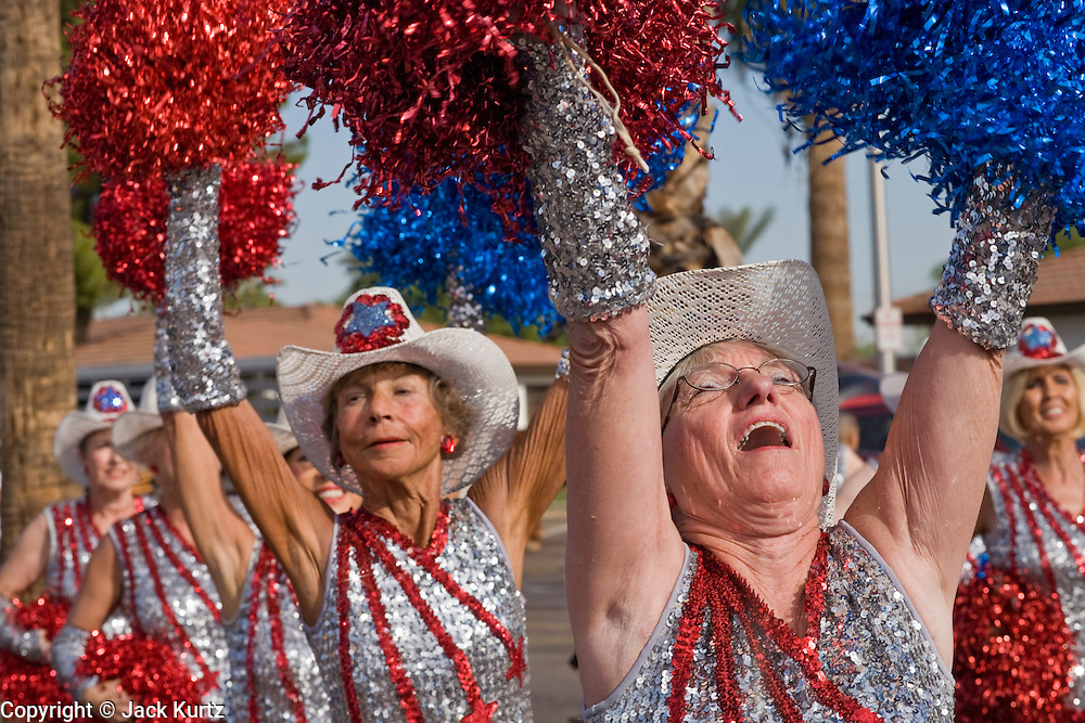 12 NOVEMBER 2007 -- PHOENIX, AZ: JANE FREAS, and other members of the Sun City Poms, a group of senior citizen cheerleaders from Sun City, AZ, march in the Veterans' Day Parade in Phoenix, AZ. According the Veterans' Administration, the Veterans' Day Parade in Phoenix, AZ, is the fourth largest Veterans' Day parade in the US. Photo by Jack Kurtz / ZUMA Press