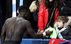 Bacary Sagna of Manchester City gives his shirt to a young fan in the crowd - Mandatory by-line: Robbie Stephenson/JMP - 06/04/2016 - FOOTBALL - Parc des Princes - Paris,  - Paris Saint-Germain v Manchester City - UEFA Champions League Quarter Finals First Leg