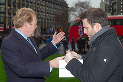 Environmental entrepreneur and People's Vote campaigner Charles Perry speaks with Bild journalist Philip Fabian outside the Houses of Parliament in London. London, January 15 2019.
