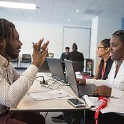 WASHINGTON, DC -JUL23: Tynice Simpson, a success coach at the Department of Employment Services, works with Craig Brown-Dickens, 22, a student at Cheyney Univiersity, on potential career opportunities, during a workshop for 22-24 year old participants in DC's Student Youth Employment Program, SYEP, at the Department of Employment Services in Northeast, Washington, DC, July 23, 2015. (Photo by Evelyn Hockstein/For The Washington Post)