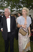 Tamara Beckwith and her uncle, John Beckwith. Louis Vuitton Concours d'Elegance, Hurlingham.  8 June 2002.  Copyright Photograph by Dafydd Jones 66 Stockwell Park Rd. London SW9 0DA Tel 020 7733 0108 www.dafjones.com