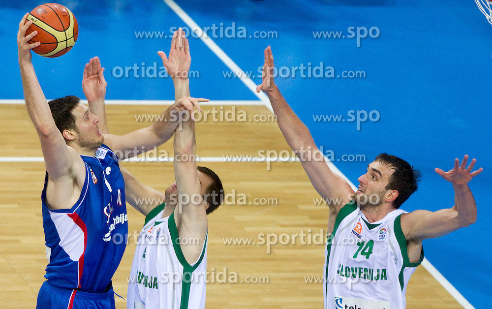 Kosta Perovic of Serbia vs Uros Slokar of Slovenia and Mirza Begic of Slovenia during basketball game between National basketball teams of Slovenia and Serbia in 7th place game of FIBA Europe Eurobasket Lithuania 2011, on September 17, 2011, in Arena Zalgirio, Kaunas, Lithuania. Slovenia defeated Serbia 72 - 68 and placed 7th. (Photo by Vid Ponikvar / Sportida)