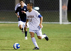 Hofstra midfielder/forward Justin Flood (21) in action against UVA.  The Virginia Cavaliers defeated the Hofstra Pride 4-2 in NCAA men's soccer at Klockner Stadium on the Grounds of the University of Virginia in Charlottesville, VA on September 7, 2008