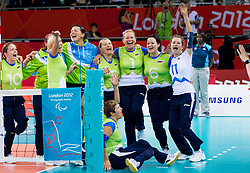 Sasa Kotnik of Slovenia, Danica Gosnak of Slovenia, Marinka Cencelj of Slovenia, Anita Goltnik Urnaut of Slovenia, Suzana Ocepek of Slovenia and Lena Gabrscek of Slovenia celebrate after winning the 5th - 8th place sitting volleyball match between National teams of Slovenia and Japan during Day 7 of the Summer Paralympic Games London 2012 on September 4, 2012, in ExCel Exhibition centre, London, Great Britain. Slovenia defeated Japan 3-0. (Photo by Vid Ponikvar / Sportida.com)