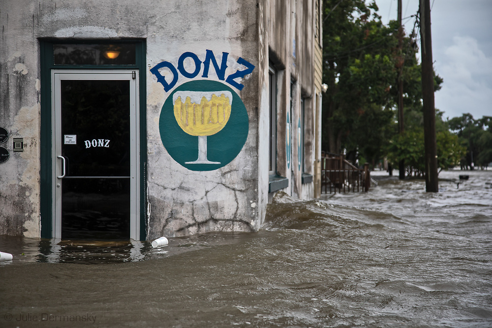 Donz bar in Mandeville flooded during  Hurricane Barry. The bar is on Mandeville's lakefront.   Lake Pontchartrain's water topped the seawall and flooded nearby streets.