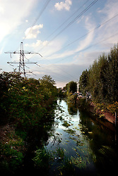 UK ENGLAND LONDON 9AUG06 - Power station and transformers next to the urban river Wandle near Wimbledon in south London.. . jre/Photo by Jiri Rezac. . © Jiri Rezac 2006. . Contact: +44 (0) 7050 110 417. Mobile:  +44 (0) 7801 337 683. Office:  +44 (0) 20 8968 9635. . Email:   jiri@jirirezac.com. Web:    www.jirirezac.com. . © All images Jiri Rezac 2006 - All rights reserved.