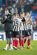 Grimsby Town players applaud the travelling fans after The FA Cup 3rd round match between Crystal Palace and Grimsby Town FC at Selhurst Park, London, England on 5 January 2019.