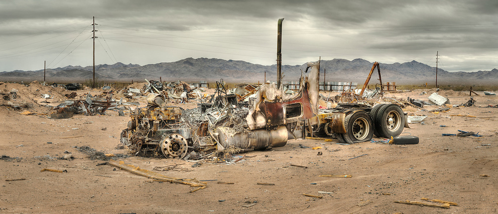 Panoramic photograph of the burned remains of a truck in a junk yard along historic US highway Route 66 in Essex CA, east of Amboy, California USA. Mojave Desert..©Rich Frishman.