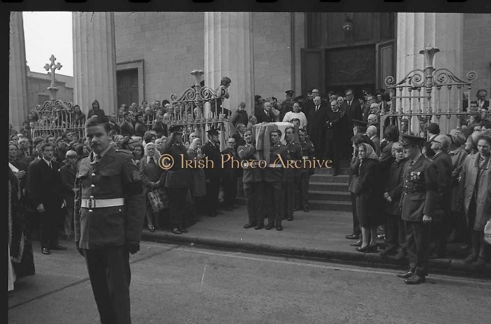 State Funeral Of Mrs Thomas Clarke..1972..08.10.1972..10.08.1972..8th October 1972..Today the state funeral of Mrs Kathleen Clarke took place at the Pro Cathedral,Dublin. Mrs Clarke was the wife of the late Thomas Clarke who was executed in Kilmainham Jail in 1916. Thomas Clarke was a signatory of the Irish Proclamation of 1916...Image taken as the mortal remains of Mrs Kathleen Clarke is carried from the Pro Cathedral. President DeValera is seen leading the mourners behind the Tricolour draped coffin.
