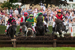 © Licensed to London News Pictures. 16/07/2015. Bradford, UK. Picture shows children racing Shetland ponies at the 157th Great Yorkshire show in Harrogate. Photo credit : Andrew McCaren/LNP