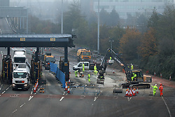 © Licensed to London News Pictures. 30/11/2014.  The new payment system at the Dartford crossing started today. It was a quiet, foggy Sunday morning at the crossing as vehicles try the new system which still requires them to stop at the existing tolling booths until they are demolished. The new Dart Pay remote system requires users to pay by account or with a one off charge (increased from £2 to £2.50) online, similar to the London Congestion Charge. . Credit : Rob Powell/LNP