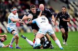Huw Taylor of Dragons is tackled by D'arcy Rae of Glasgow Warriors - Ryan Hiscott/JMP - 25/10/19 - SPORT - Rodney Parade - Newport, Wales -