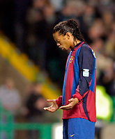 Photo. Jed Wee.Digitalsport<br /> Glasgow Celtic v Barcelona, UEFA Cup, Celtic Park, Glasgow. 11/03/2004.<br /> Barcelona's Brazilian star Ronaldinho remains motionless in earnest prayer for the victims of the terrorist attack in Spain after the minute's silence.