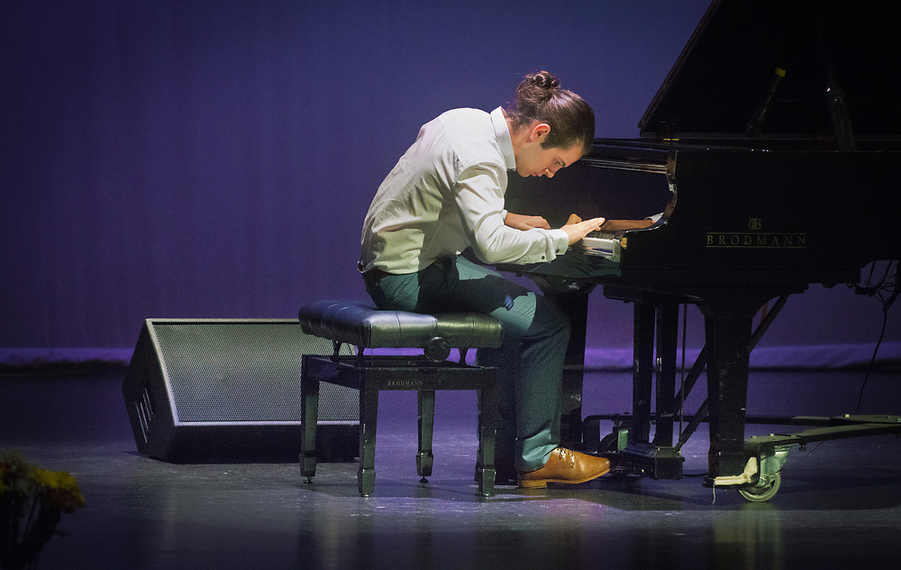 """mkb072617a/metro/Marla Brose --  Ki Cooley-Winters, a senior at Desert Academy in Santa Fe plays John Lewis' """"A Night in Tunisia"""" during the 2017 John Lewis Youth Jazz Piano Competition, July 26, 2017, in Albuquerque, N.M.  The winner of the piano competition plays Thursday night  to open the Ambrose Akinmusire Quartet concert at the South Broadway Cultural Center. Both events celebrating John Lewis, are part of the New Mexico Jazz Festival. The festival continues through August 5. (Marla Brose/Albuquerque Journal)"""