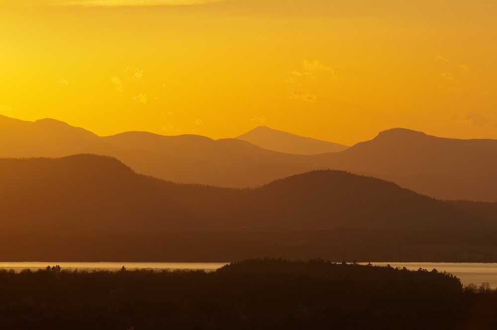 Adirondack Mountains and Lake Champlain at sunset from Burlington, Vermont.