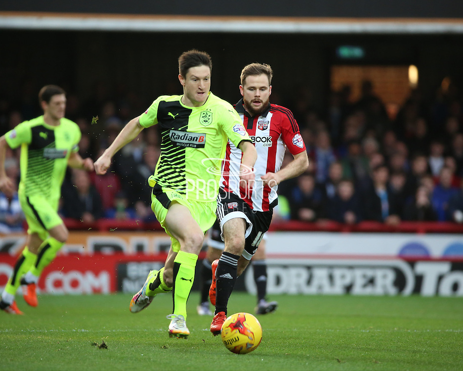 Hudderfield Town striker Joe Lolley trying to get Hudderfield Town back in the game after conceding early during the Sky Bet Championship match between Brentford and Huddersfield Town at Griffin Park, London, England on 19 December 2015. Photo by Matthew Redman.