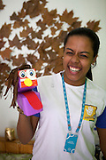 A C&A Instituto volunteer making children's toys out of recycled materials.