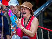 13 APRIL 2018 - BANGKOK, THAILAND:  A water fight on Silom Road during the first day of Songkran in Bangkok. Songkran is the traditional Thai New Year celebration best known for water fights.    PHOTO BY JACK KURTZ