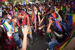 © Licensed to London News Pictures. 25/11/2012. New Delhi, India. Crowds dance. Homosexuals, bisexuals and transgenders take part in the Gay Pride Parade in New Delhi on 25 November 2012. Legalising homosexuality has had little impact on the deeply entrenched homophobia in India, where thousands of gays still face discrimination and a lack of basic rights. Photo credit : Andrew Ash/LNP