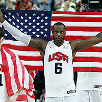 12 August 2012: USA LeBron James holds the US flag following the 107-100 Team USA victory over Team Spain, during the men's Gold Medal Game, at the North Greenwich Arena, in London, Great Britain.