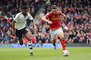 Nottingham Forest midfielder Chris Cohen (8) running away from Fulham midfielder, Rohan Ince (31) during the Sky Bet Championship match between Fulham and Nottingham Forest at Craven Cottage, London, England on 23 April 2016. Photo by Matthew Redman.