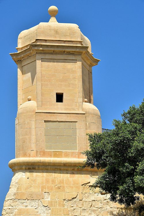 Sentry Box on Saint James Cavalier in Valletta, Malta <br /> Valletta is surrounded by high bastions. Protecting the west end are two cavaliers, a term originally used to define a knight who once stood on these platforms to protect the city. This sentry box is part of the St. James Cavalier. This massive limestone wall was built in the mid-16th century within a couple years of when Valletta was founded. In 2000, part of this structure was transformed into the St. James Cavalier Centre for Creativity.  They host a variety of cultural activities ranging from the visual arts, theater and music.