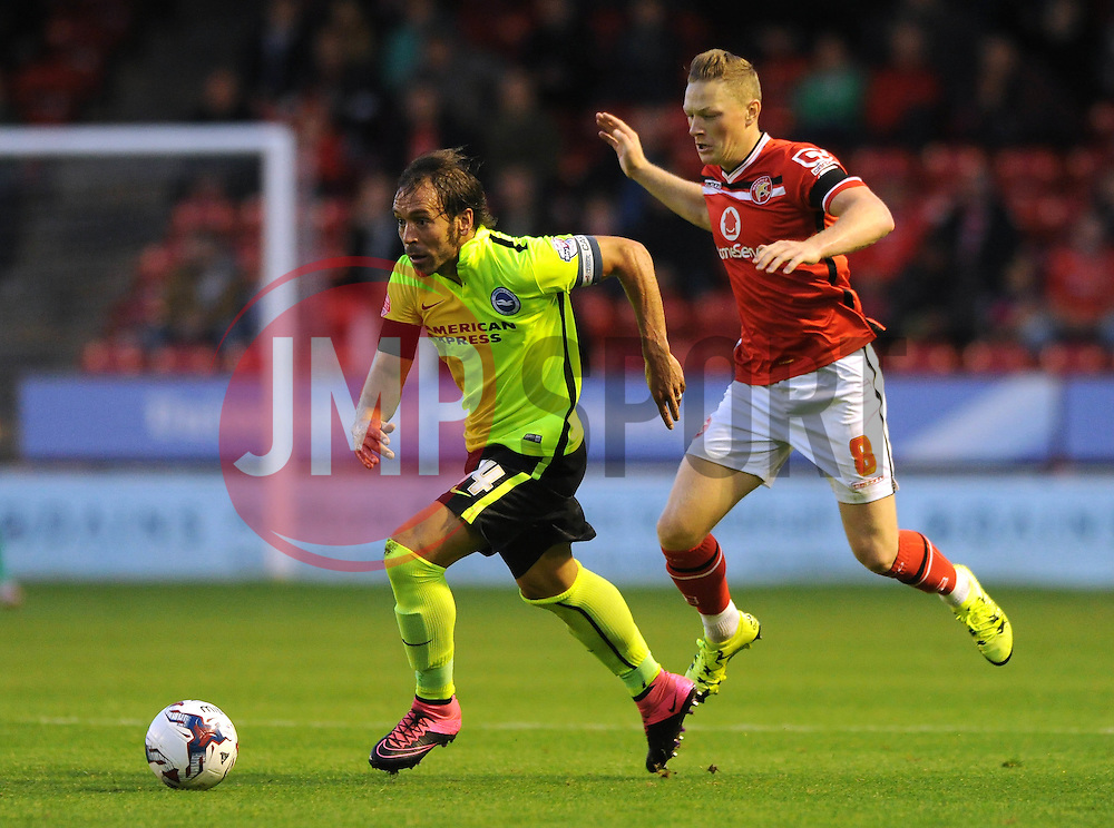 Inigo Calderon of Brighton & Hove Albion is chased down by Sam Mantom of Walsall - Mandatory byline: Dougie Allward/JMP - 07966386802 - 25/08/2015 - FOOTBALL - Bescot Stadium -Walsall,England - Walsall v Brighton - Capital One Cup - Second Round
