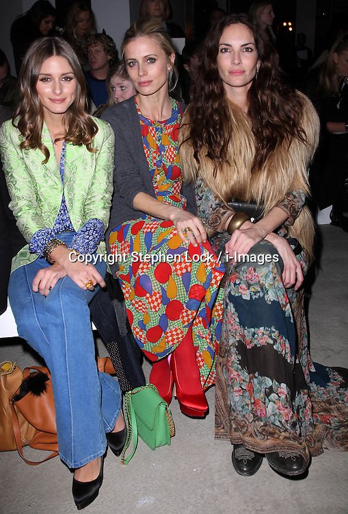 Olivia Palermo, Laura Bailey and Eugenia de Silva at the Jonathan Saunders show  at London Fashion Week A/W 2012. Sunday ,19th February 2012. Photo by: Stephen Lock / i-Images