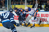 PENTICTON, CANADA - SEPTEMBER 9: Sahvan Khaira #86 of Edmonton Oilers checks Francis Beauvillier #93 of Winnipeg Jets at the boards during second period on September 9, 2017 at the South Okanagan Event Centre in Penticton, British Columbia, Canada.  (Photo by Marissa Baecker/Shoot the Breeze)  *** Local Caption ***