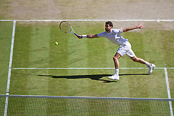 LONDON, ENGLAND - Friday, July 4, 2014: Grigor Dimitrov (BUL) during the Gentlemen's Singles Semi-Final match on day eleven of the Wimbledon Lawn Tennis Championships at the All England Lawn Tennis and Croquet Club. (Pic by David Rawcliffe/Propaganda)