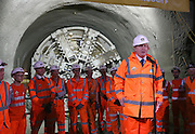 "The Prime Minister and Mayor of London Boris Johnson celebrated the completion of Crossrail's tunnels by going 40 metres below the capital to thank the men and women who are constructing the new £14.8 billion east-west railway.<br />  <br /> Prime Minister David Cameron said: ""Crossrail is an incredible feat of engineering that will help to improve the lives of working people in London and beyond. The project is a vital part of our long term plan to build a more resilient economy by helping businesses to grow, compete and create jobs right along the supply chain.""<br />  <br /> Crossrail tunnelling began in the summer of 2012 and ended at Farringdon with the break through of tunnelling machine Victoria. Eight 1,000 tonne tunnelling machines have bored 26 miles or 42 km of new 6.2m diameter rail tunnels under London.<br />  <br /> Construction is also advancing on the ten new Crossrail stations and on works above ground west of Paddington and east of Stratford. Over 10,000 people are currently working on Crossrail, including over 450 apprentices.<br />  <br /> With the arrival of Crossrail in 2018, Farringdon will become one of the UK's busiest rail hubs with direct connections to London Underground and upgraded and expanded Thameslink services. This brand new interchange will transform the way passengers travel through London and the South East, providing more capacity and direct connections to three of London's five airports and international rail services at St Pancras. Passengers will also benefit from quicker connections and will be able to travel to Tottenham Court Road in three minutes, Heathrow in just over 30 minutes and Canary Wharf in nine minutes.<br />  <br /> Crossrail will add 10% capacity to London's rail network. It will serve 40 stations, connecting Reading and Heathrow in the west with Shenfield and Abbey Wood in the east. TfL-run Crossrail services through central London will commence in December 2018. An estimated 200 million passengers will travel on Crossrail each year.<br />  <br /> On 31 May this yea"