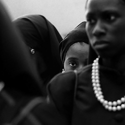 Chicago, Ill. -  A yound MGT attentatively waits for the start of a class on sexual morality during the Savior's Day Weekend convention in Chicago. The convention celebrates the birth Farrad Muhammad, founder of the Nation of Islam.