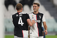 Juventus's Dutch defender Matthijs De Ligt celebrates wit  Welsh midfielder Aaron Ramsey after scoring to give the side a 4-0 lead during the Serie A match at Allianz Stadium, Turin. Picture date: 26th June 2020. Picture credit should read: Jonathan Moscrop/Sportimage