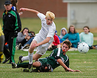 Gilford's Owen Ramsey and Newfound's Logan Rouille get tripped up during second round tournament play for NHIAA Division III soccer on Thursday afternoon.  (Karen Bobotas/for the Laconia Daily Sun)