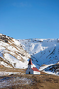 Traditional quaint Icelandic wooden Lutheran church Vikurkirkja at Vík i Myrdal, South Iceland
