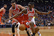 Nov 18, 2015; Phoenix, AZ, USA; Chicago Bulls forward Tony Snell (20) looks at the loose ball alongside teammate guard Kirk Hinrich (12) in the game against the Phoenix Suns at Talking Stick Resort Arena. The Bulls won 103-97. Mandatory Credit: Jennifer Stewart-USA TODAY Sports