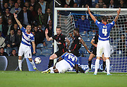 Jay Emmanuel-Thomas (QPR midfielder) going down near the end of the game looking for a penalty during the Capital One Cup match between Queens Park Rangers and Carlisle United at the Loftus Road Stadium, London, England on 25 August 2015. Photo by Matthew Redman.