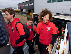 CARDIFF, WALES - Monday, September 4, 2017: Wales' Joe Allen, Ben Woodburn and Ethan Ampadu board the team plane as the squad depart Cardiff Airport to travel to Chișinău ahead of the 2018 FIFA World Cup Qualifying Group D match against Moldova. (Pic by David Rawcliffe/Propaganda)