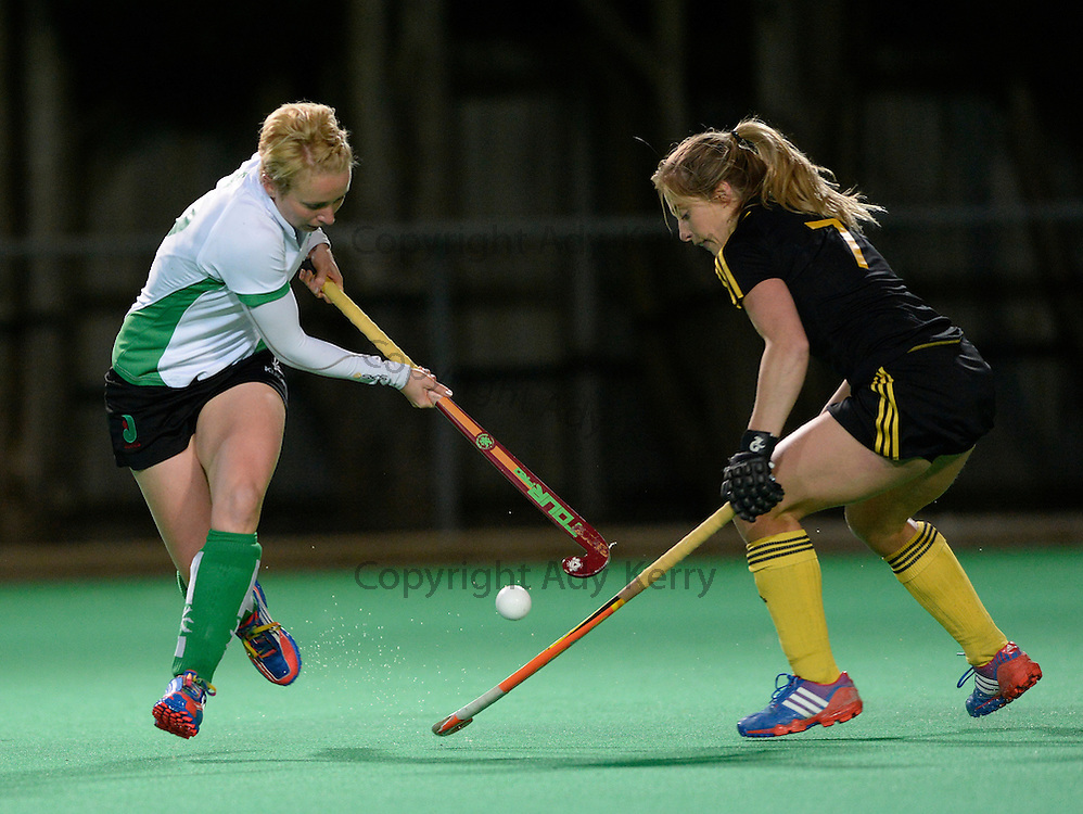 Canterbury's Nikki Lloyd is challenged by Beeston's Suzy Petty during their Investec Women's Hockey League Premier Division game at Canterbury HC, 22nd February 2014.