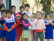Burmese school children; some with yellow paste on face for sunscreen; Tachilek; Myanmar