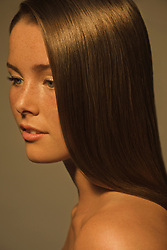 Close up Profile of Young Woman with Glossy Straight Hair