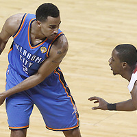 21 June 2012: Miami Heat point guard Mario Chalmers (15) defends on Oklahoma City Thunder shooting guard Thabo Sefolosha (2) during the Miami Heat 121-106 victory over the Oklahoma City Thunder, in Game 5 of the 2012 NBA Finals, at the AmericanAirlinesArena, Miami, Florida, USA. The Miami Heat wins the series 4-1.
