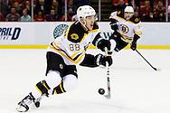 Apr 2, 2015; Detroit, MI, USA; Boston Bruins right wing David Pastrnak (88) make a pass in the first period ad at Joe Louis Arena. Mandatory Credit: Rick Osentoski-USA TODAY Sports