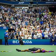 2019 US Open Tennis Tournament- Day Fourteen.   Rafael Nadal of Spain lays on the court in exhaustion after his five set win against Danill Medvedev of Russia in the Men's Singles Final on Arthur Ashe Stadium during the 2019 US Open Tennis Tournament at the USTA Billie Jean King National Tennis Center on September 8th, 2019 in Flushing, Queens, New York City.  (Photo by Tim Clayton/Corbis via Getty Images)