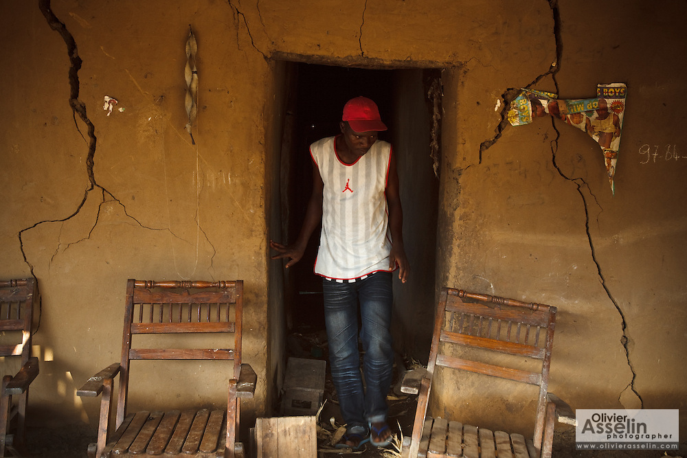 A man walks out of a home with badly cracked walls from floodwater damage in the village of Kpoto, Benin on Tuesday October 26, 2010.  Waters have receded in Kpoto, but most of the village was literally flattened by floods that have hit Benin over the past few weeks..