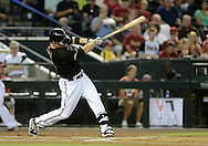 Jul 10, 2013; Phoenix, AZ, USA;  Arizona Diamondbacks infielder Aaron Hill (2) hits a solo home run against the Los Angeles Dodgers in the first inning at Chase Field. Mandatory Credit: Jennifer Stewart-USA TODAY Sports