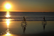 Kids Riding their Bikes at Low Tide on the Beach in Orange County