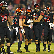 18 November 2017:  The San Diego State football team hosts Nevada Saturday night. San Diego State Aztecs wide receiver Mikah Holder (6) is congratulated by his teammates after scoring a touchdown late in the second quarter to give the lead back to the Aztecs. The Aztecs lead 21-14 at the half. <br /> www.sdsuaztecphotos.com