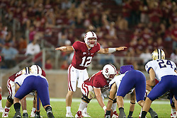 September 26, 2009; Stanford, CA, USA; Stanford Cardinal quarterback Andrew Luck (12) calls an audible at the line of scrimmage against the Washington Huskies during the third quarter at Stanford Stadium. Stanford defeated Washington 34-14. Mandatory Credit: Jason O. Watson-US PRESSWIRE